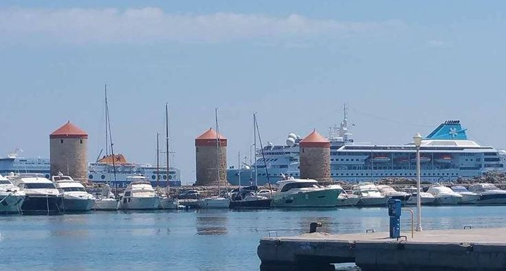 The Tourist Port and Akandia Port set behiond the three windmills!  https://theislandofrhodes.com/rhodes-town-in-greece