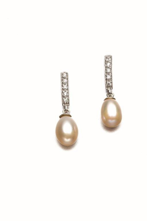 A beautiful pair of fresh-water pearl and cubic zirconia sterling silver earrings