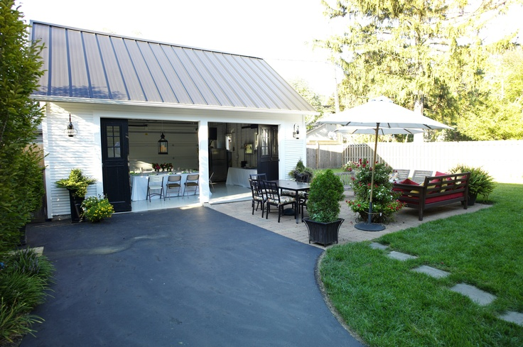 Garage exterior renovation black metal roof cape cod for Converting a pole barn into living space