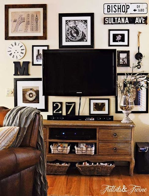 Top This Top That decorating blog.  Neat picture arrangement, gets rid of the black hole...TV.