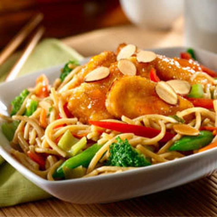Crispy Orange Chicken Bowl Recipe Main Dishes with chicken nugget, knorr asian side teriyaki noodl, stir fry vegetable blend, almonds, apricot preserves, reduced sodium soy sauce, white vinegar