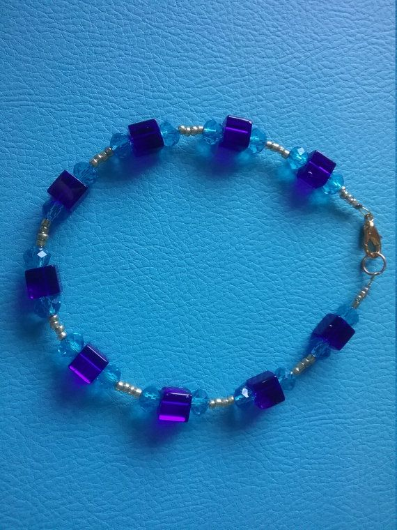Hey, I found this really awesome Etsy listing at https://www.etsy.com/au/listing/264455836/blue-gold-swarvoski-bracelet