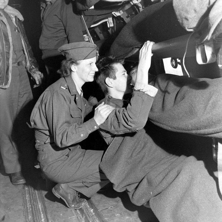 Flight nurse with wounded soldiers ready for Air repatriation