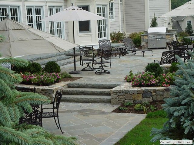 raised concrete patio design ideas raised patio with outdoor kitchen and fireplace in new jersey - Raised Patio Ideas