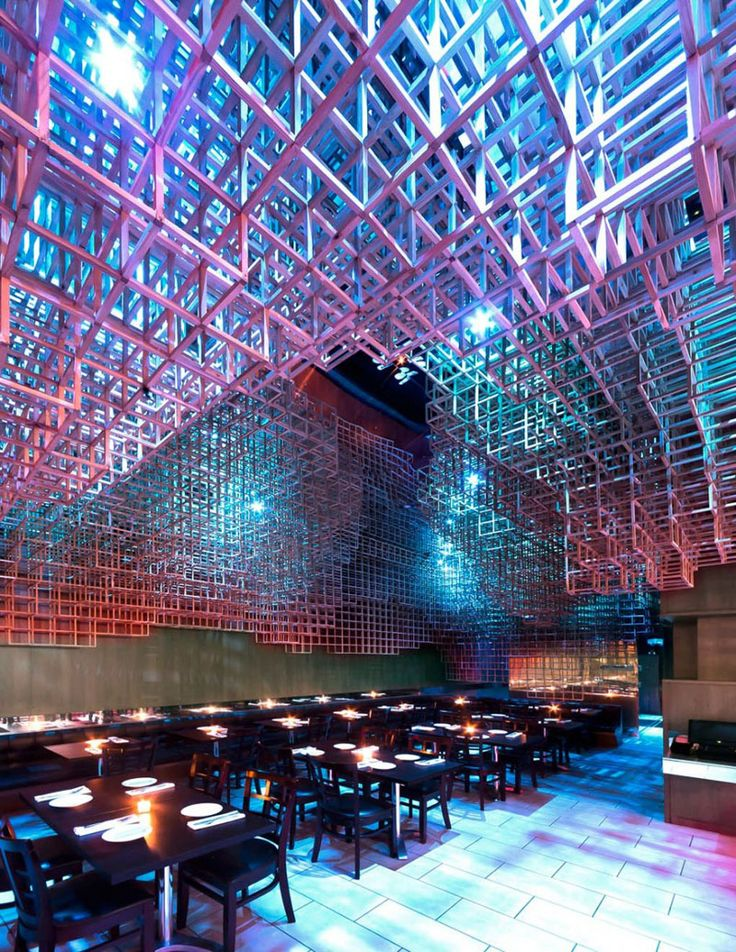 13 Amazing Examples Of Creative Sculptural Ceilings // This restaurant ceiling installation is a three-dimensional, cloud-like, organic formation, made from poplar wood.