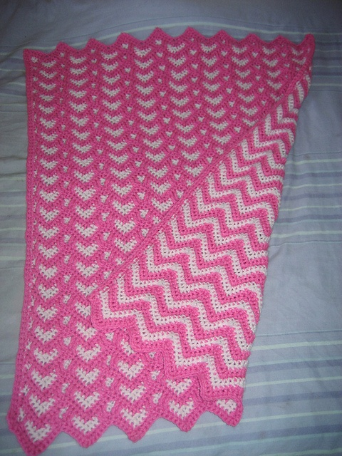 Ravelry: Sweetheart Ripple Afghan Pattern by Kim Guzman. Just like magic; hearts on one side and stripes on the other.