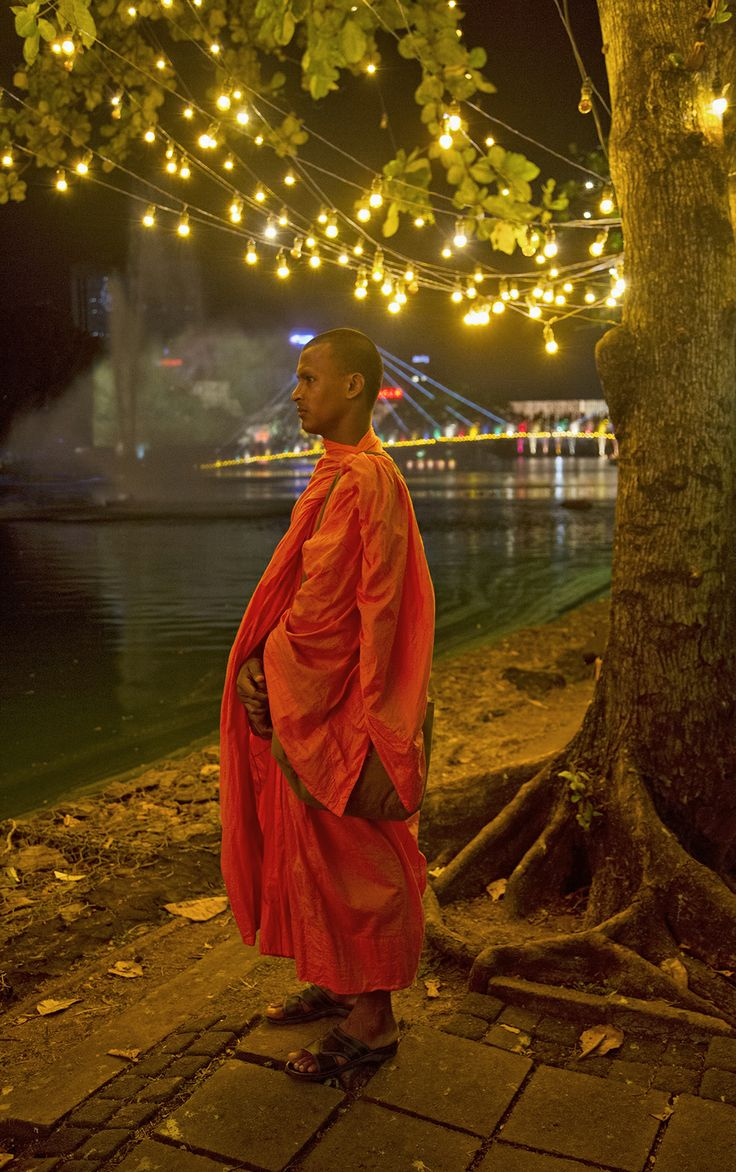 On my recent trip to Sri Lanka, this Buddhist monk was kind enough to pose for me. I like the lights above his head; show some enlightenment.  For a larger view click here bit.ly/TSvmtT