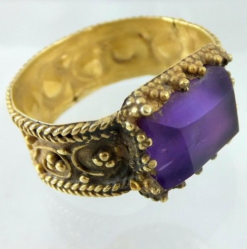Late Byzantine gold and amethyst ring. Ca. 800 A.D. The oblong cut pyramid shaped amethyst could be a later replacement. Width of the band:8 mm