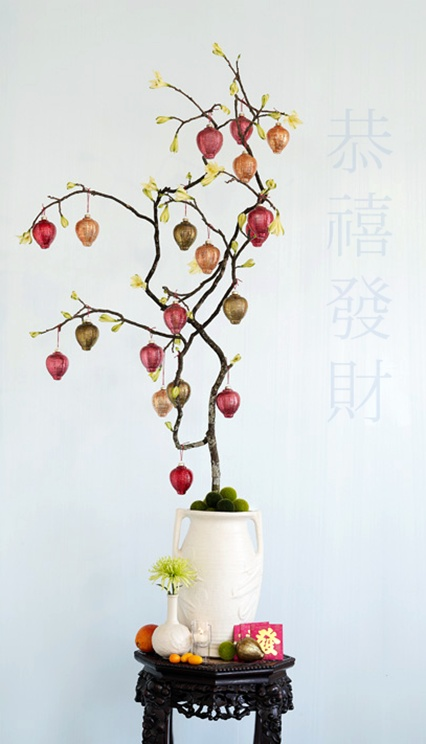 "Chinese New Year | This ""forced"" tree branch is made quite elegant with the addition of mercury glass lantern ornaments. The traditional paper lanterns used on the fifteenth day of the Chinese New Year for the Lantern Festival, are bright, colorful, and in many different shapes and sizes. See more at http://www.thedecoratedtree.blogspot.com/2010/02/year-of-tiger.html"
