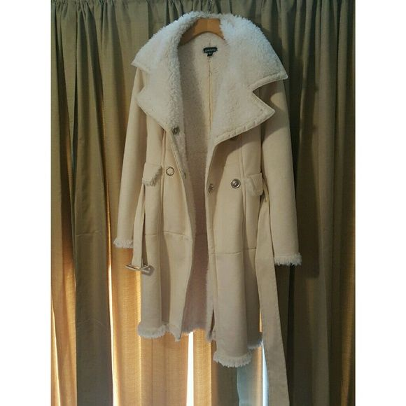 Bebe Coat !! New without tags Warm Ivory Color Coat. Bought but in this state it doesn't get Cold enough to wear so I never got to wear it!! It is not suede it's a very soft polyester material . bebe Jackets & Coats
