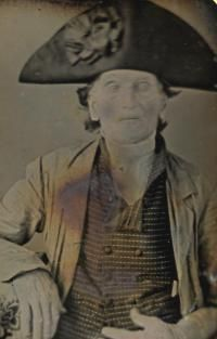 Revolutionary War veteran photographed in the 1800s, wearing his hat with the early American black cockade
