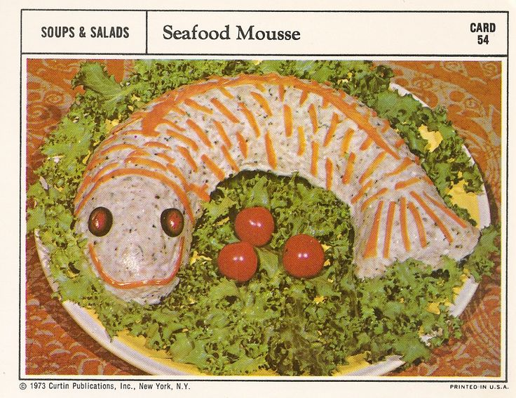 Seafood Mousse...  I don't care if it IS smiling;  Out of all the fish mold recipes I have seen, this is the most frightening.  I think those eyes are following me around the room.