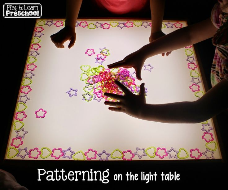 Patterning on the light table at Play to Learn Preschool
