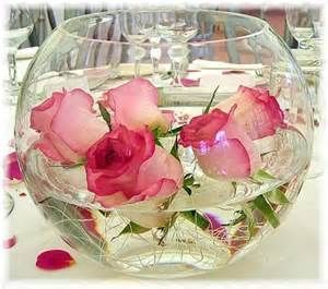 Create a beautiful Quinceanera centerpiece with submersible roses. #quinceanera #quinceaneracenterpiece #diyquinceanera #afloral.com