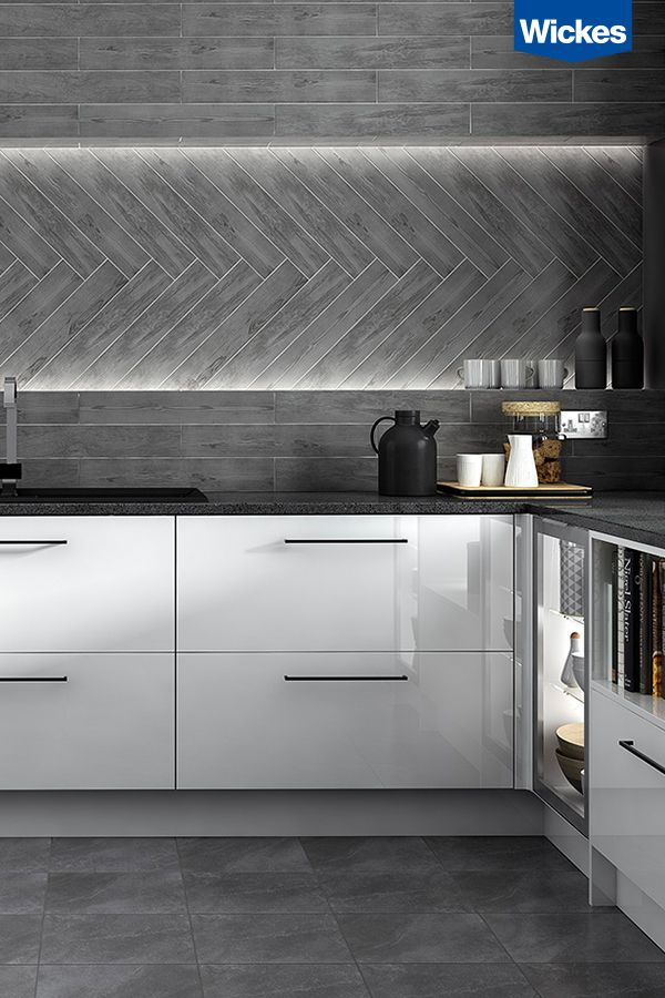 Contrast high gloss dazzling white cabinets with a statement black quartz worktop. Get creative and mix tile patterns to reflect your unique style.