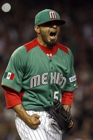 Mexico's Sergio Romo celebrates the final out against the United States after the final out in a World Baseball Classic baseball game on Friday, March 8, 2013, in Phoenix.  Mexico defeated the United States 5-2. (AP Photo/Ross D. Franklin) Photo: Ross D. Franklin, Associated Press