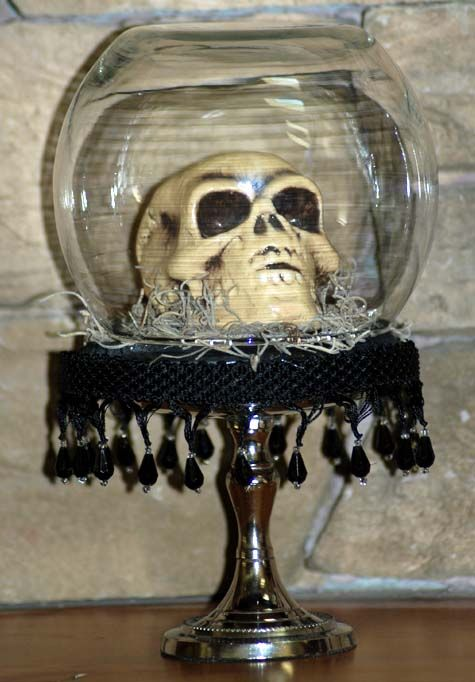 Skull in a glass jar - very spooky (shiver)