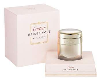 Cartier 'Baiser Vole' Extrait de Parfum presents the carnal, sensual side of the Eau de Parfum by accentuating the finest ingredients of the opulent and voluptuous lily. The extrait is presented in a golden bottle arrayed with light.