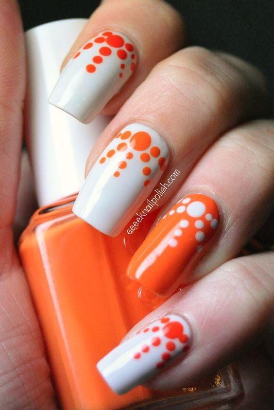Orange and white polka dots diverging nail art