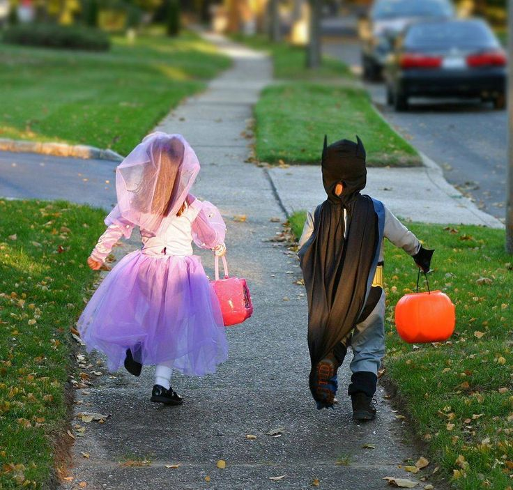 Happy Halloween!  Here are some simple tips to help keep safe on this magical night:   1. Fasten reflective tape to costumes and bags to help drivers see you.  2. Walk in groups or with a trusted adult.  3. Hold a flashlight while trick-or-treating to help you see and others see you.  4. Stay on sidewalks whenever possible, or on the far edge of the road facing traffic.   7. Enter homes only if you're with a trusted adult.  8. Only visit well-lit houses. Don't stop at dark houses.: