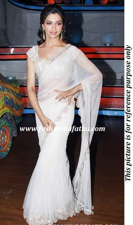 Deepika Padukone style white net saree with a flared lehenga touch and mirror work border running all over the sides teamed with a white mirror work embroidered blouse.