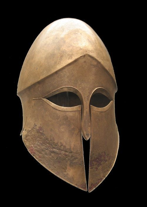 Corinthian helmet from the tomb of Denda. From a Greek workshop in South Italy, 500–490 BC. Wikipedia: The Corinthian helmet originated in ancient Greece and took its name from the city-state ofCorinth. It was a helmet made of bronze which in its later styles covered the entire head and neck, with slits for the eyes and mouth. A large curved projection protected the nape of the neck. It also protected the cheek bones, which Greeks adored....