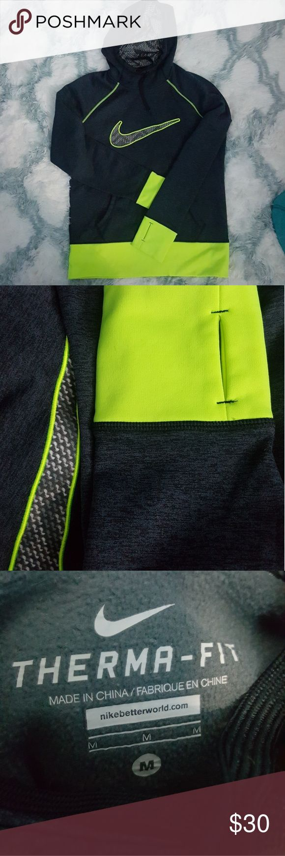 Nike Therma-Fit Hoodie Sweatshirt Active Medium Nike Therma-Fit Hoodie Sweatshirt  Size Medium (fits like Womens) Thumbholes Drawstring Hoodie charcoal marble like print with neon highlighter yellow edges/trim Like-New Condition Nike Tops Sweatshirts & Hoodies