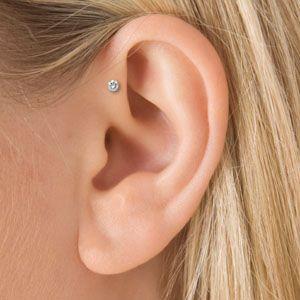 Maria Tash diamond earring on Ear Head