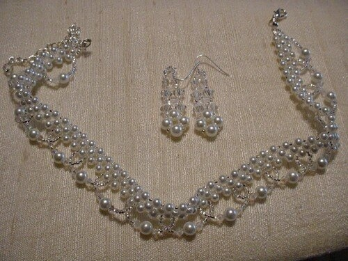 Crystal and Pearl wedding choker and matching drop earrings. Made by me, available in goldtone or silvertone. Set only $100.00. Great for the bride to be. :)