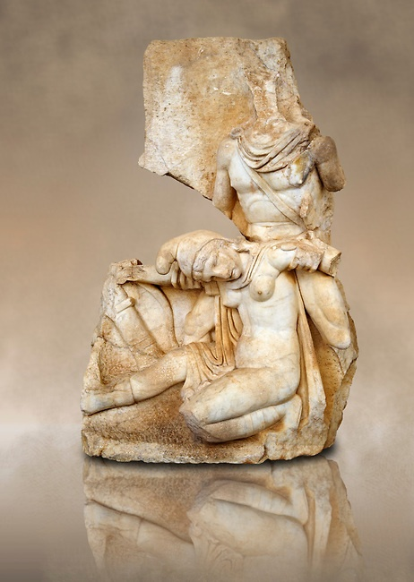 Roman relief sculpture, Aphrodisias, Turkey. Nero supports a slumping naked Armenia. She wears a soft eastern hat.