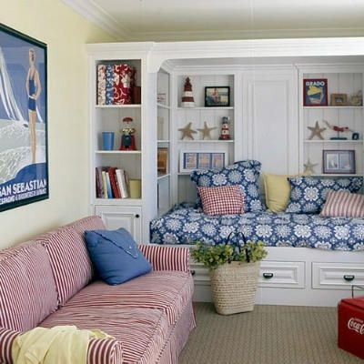 Built-in daybed with storage drawers or trundle bed underneath framed by bookcase style shelving.