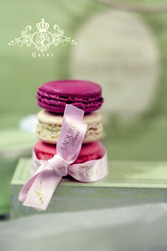 Pale pink ribbon with gold letters. Tiny green boxes filled with Laduree Paris macarons. Ridiculously lovely.