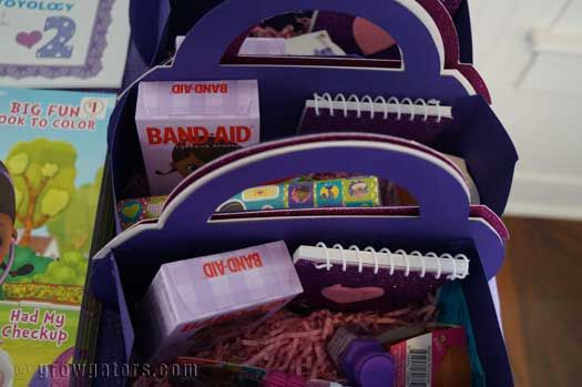 Doc McStuffins goodie bags. Details on how I made them at http://www.growgators.com/2015/03/the-doc-is-in-celebrating-2-with-a-doc-mcstuffins-party/