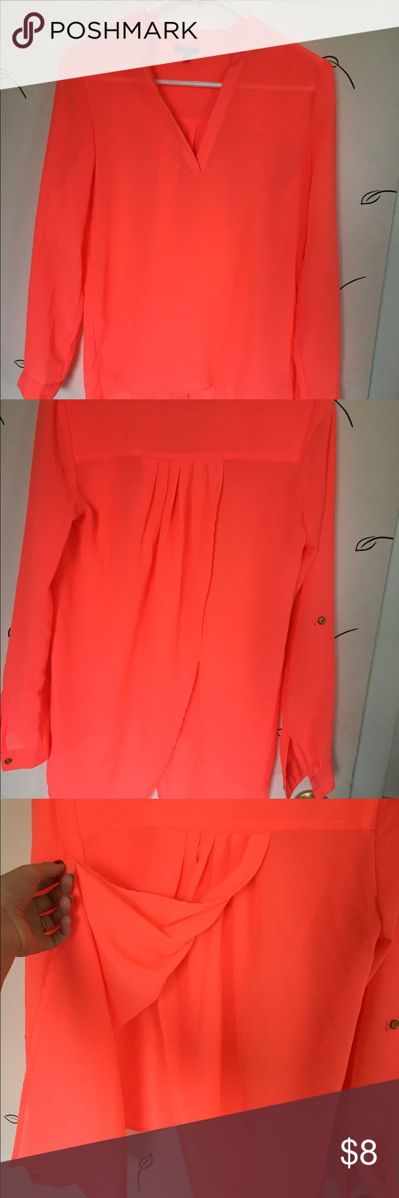 Flowy Bright Coral Blouse This blouse is a lightweight material, so a camisole underneath would be recommended. It has an open-back design, so the fabric flows open on the back. Sleeves can be worn down, or rolled up, as pictured. Pairs great with a black pencil skirt, black leggings, jeans, or shorts. Charlotte Russe Tops Blouses