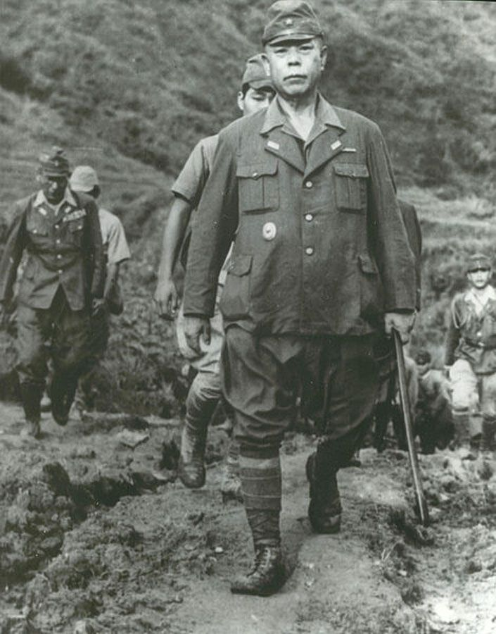 Close-up of the photograph at left depicting General Tomoyuki Yamashita, Supreme Commander of Japanese Imperial Forces, Philippines, coming out of the mountains to surrender to the 32D 'Red Arrow' Infantry Division near Kiangan, Luzon, on 2 Sep. 1945.