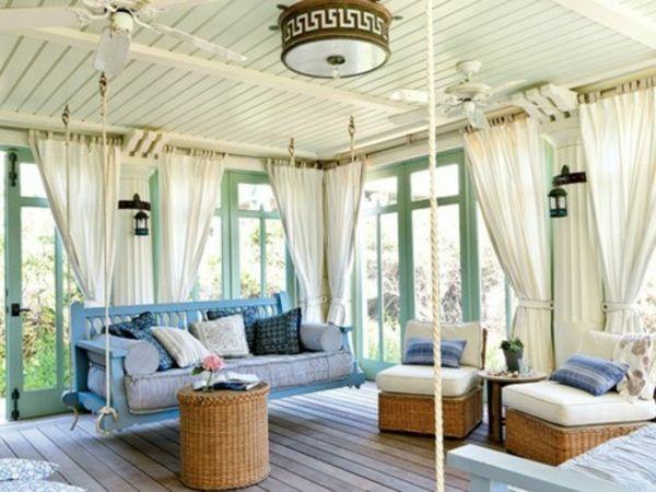 Vérandas de vos rêves-35 idées fantastiques - berceau-bleu-rideau-blanc-rotin-cottage