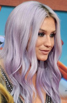 "Kesha Rose Sebert-- (born 1987), known mononymously as Kesha (formerly stylized as Ke$ha), is an American singer, songwriter, and rapper. In 2005, at age 18, Kesha was signed to producer Dr. Luke's label Kemosabe Records. Her breakthrough came in early 2009 after appearing on rapper Flo Rida's number-one single ""Right Round"". Her debut album, Animal, and her first extended play, Cannibal, were released in 2010. Kesha's music and image propelled her to immediate commercial success, with An"