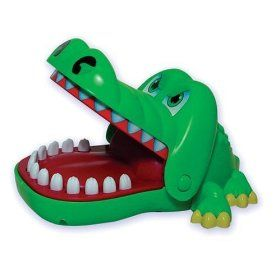 scary little thing.  Crocodile Dentist game 90s toys.. hated when i got my finger bitten