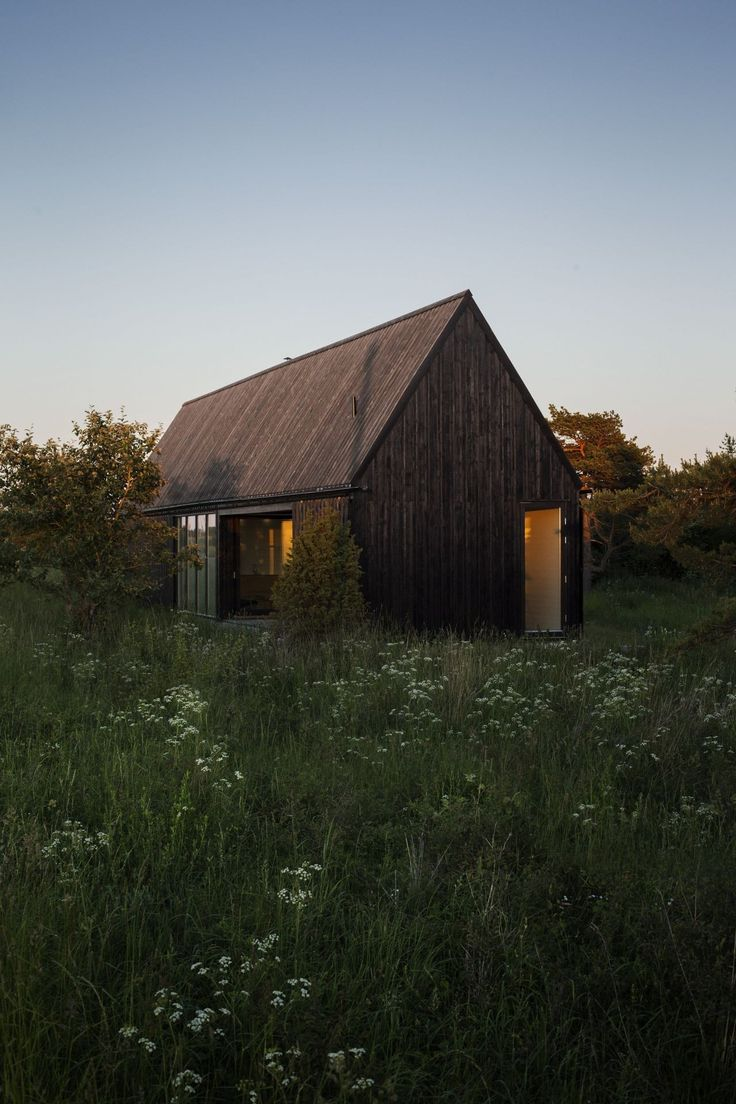 Built by Enflo Arkitekter,DEVE Architects in , Sweden with date 2012. Images by Joachim Belaieff. A summer house for a young family. The site on the Swedish island Gotland in the Baltic Sea is surrounded by open fie...
