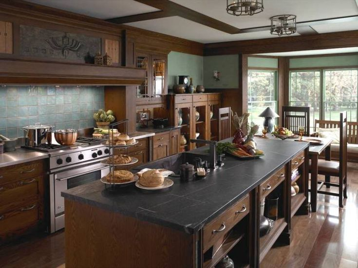 Mission kitchen: soapstone countertops, dark stained cabinetry, and green walls. Perfection.