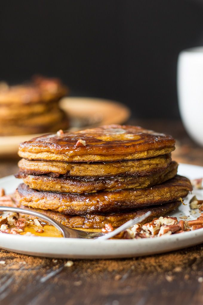 Simple and healthy Paleo Pumpkin Pancakes packed with warm and sweet pumpkin pie spices! Soft, fluffy, grain free, refined sugar free.
