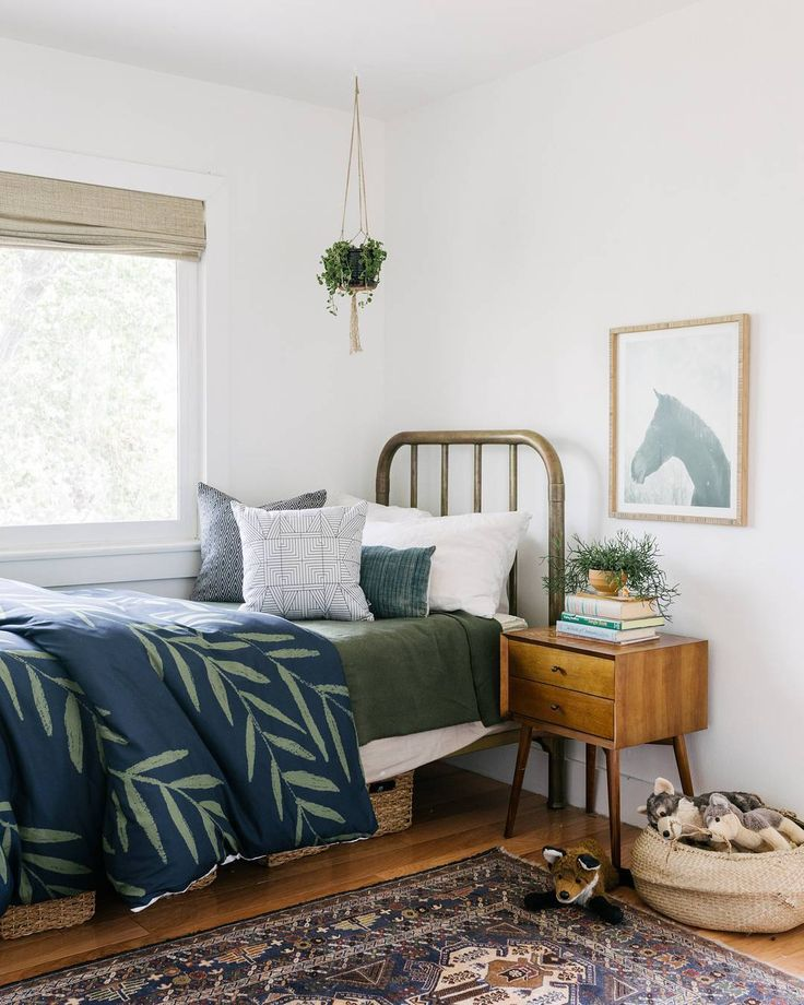 Cozy Farmhouse guest room. We love this antique copper bedframe paired with moody hues and natural art. <3
