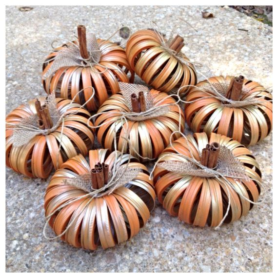 This adorable pumpkin is made with recycled mason jar lids, some burlap and cinnamon sticks!    This pumpkin would look great on your table or