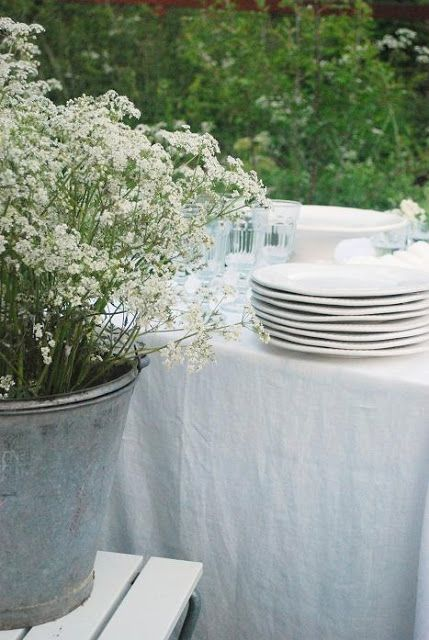 Setting | White on White with Wild Flowers in Steel Buckets
