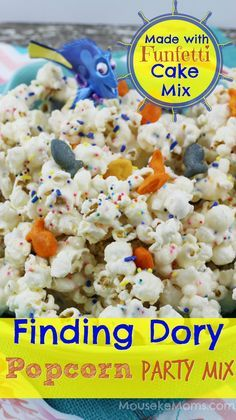 Finding Dory Funfetti Popcorn Recipe idea that uses a cake mix! How BRILLIANT and how creative. I bet this is amazing flavored popcorn and such a cute idea by adding the goldfish for a Finding Dory, Nemo, under the sea party idea! Perfect for a Sea Birthday or Disney Finding Dory or Nemo themed celebration. I just can't believe it uses a cake mix! CRAZY!