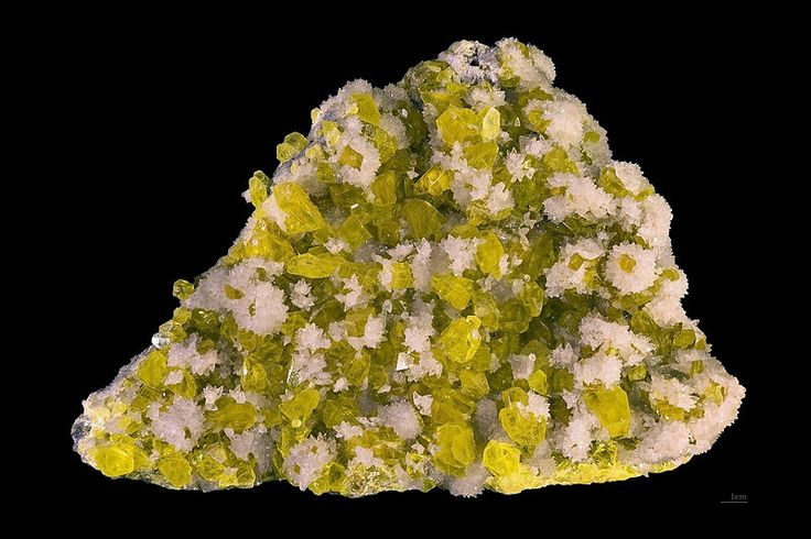 sulphur and calcite. Locality: Agrigento (Girgenti), Agrigento Province, Sicily, Italy. Size: 22 x 18 x 6 cm. Photo by Didier Descouens. / On Earth, elemental sulfur can be found near hot springs and volcanic regions in many parts of the world, especially along the Pacific Ring of Fire... http://en.wikipedia.org/wiki/Sulfur