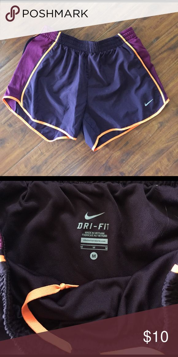 Running shorts Running shorts, hardly worn. Dark purple with orange highlight Nike Shorts