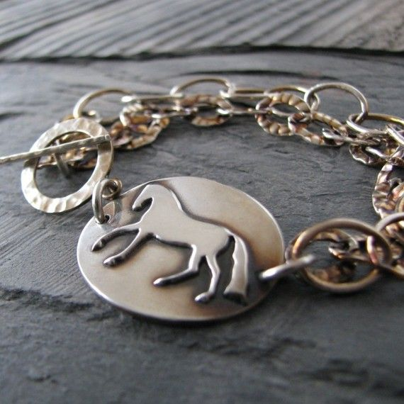 Handmade from PMC reclaimed silver, a gleaming silver horse canters across this link. Two strands of sterling chain finish the bracelet;