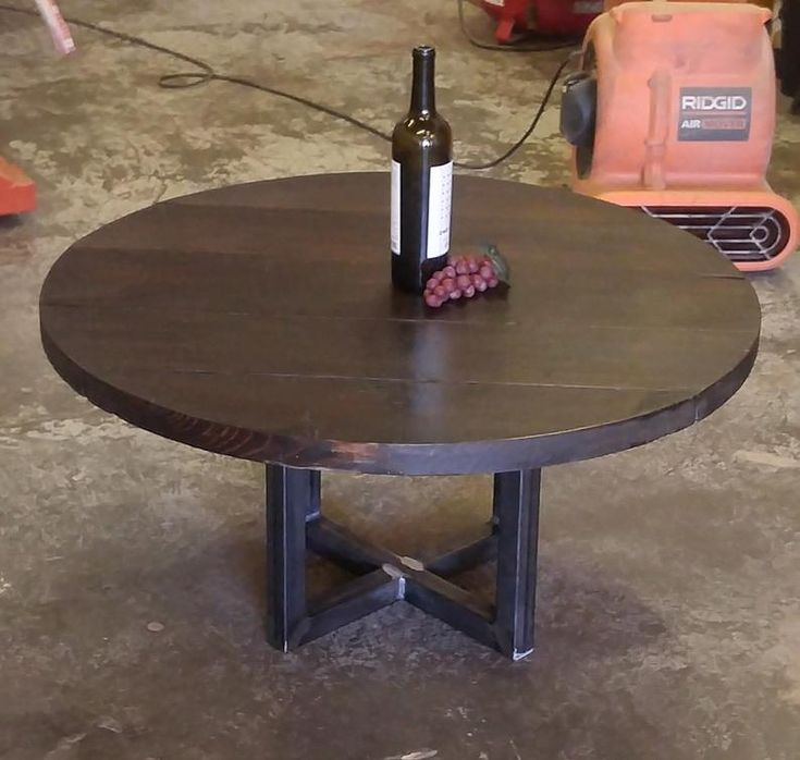 wooden dining or coffee table  the reclaimed round