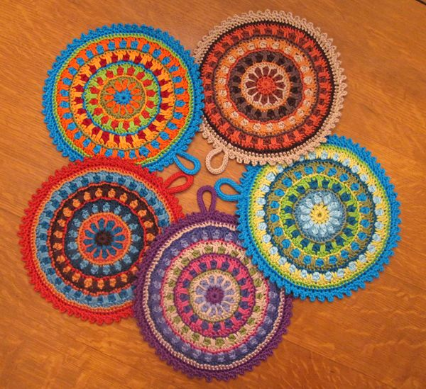 These potholders are so pretty, I would hang then!